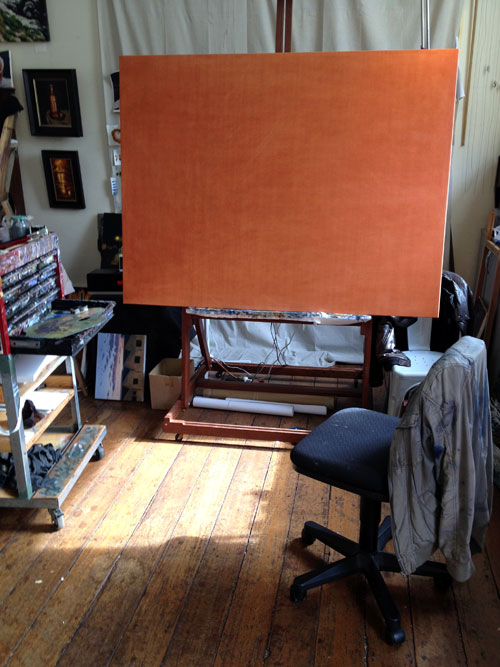 A blank canvas on an awesome artists easel in his cool studio