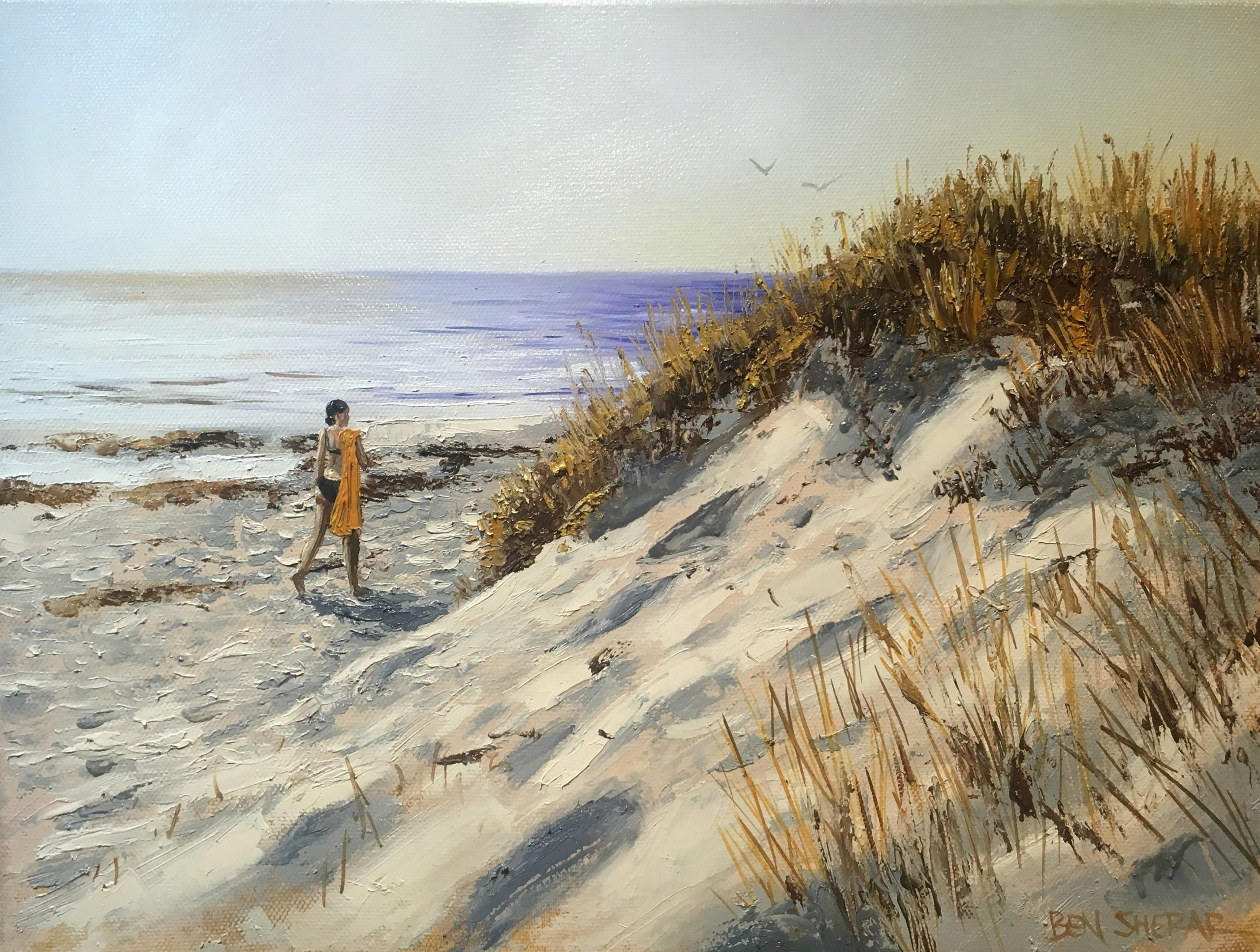An original oil painting by Ben Sherar of a woman walking along a beach at sunset