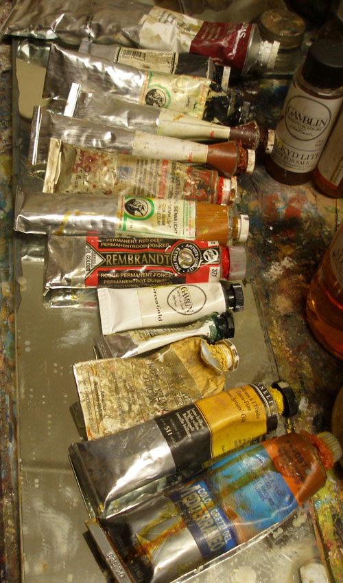 SOme oil paint tubes laid out on a palette ready to create great art