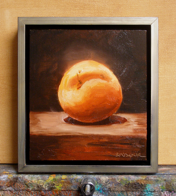 An oil painting of a whole apricot with vibrant orange colours