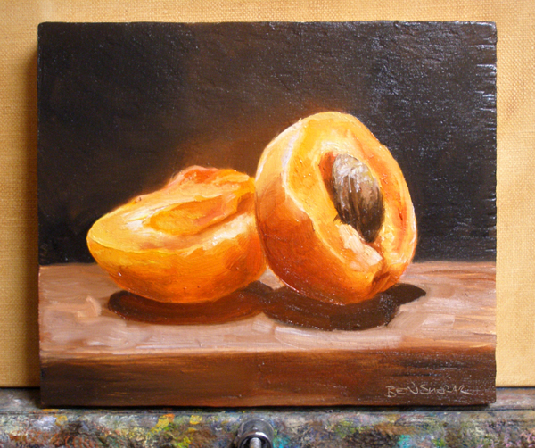 A painting of glowing orange apricot cut in half