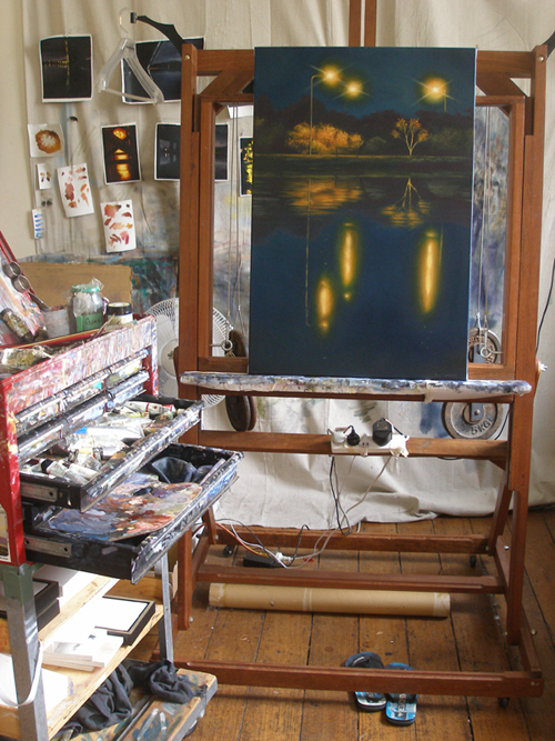 A painting on an easel in an Artists studio