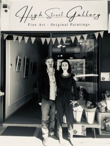 A photo of two artists standing out the front of their newly openend gallery in femantle Western Australia